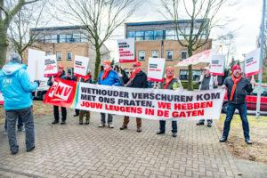 FNV eist tonnen achterstallig loon pakketsorteerders PostNL